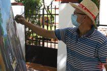 Joaquín Domínguez realizando su obra en los Callejones